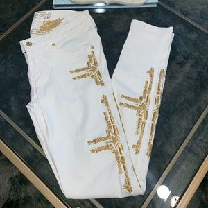 White jeans with gold embroidery